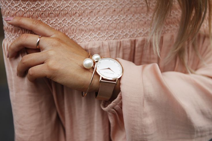 Jessie Khoo's wearing Pearl Embrace Bangle, Cut of Class Ring, and Marc Bale Rose Gold Mesh watch by @thepeachbox