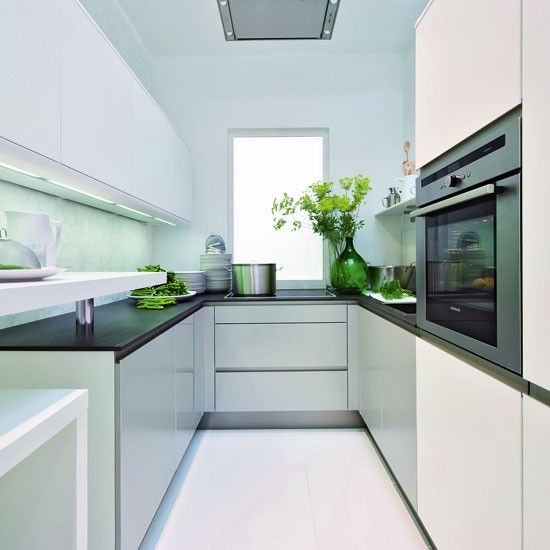 Kitchen inspiration: make the most of recessed handles for a streamlined look. The reflective finishes such as glass splashbacks, hi-gloss cabinets and stainless steel appliances  are effective in kitchens that lack natural light.
