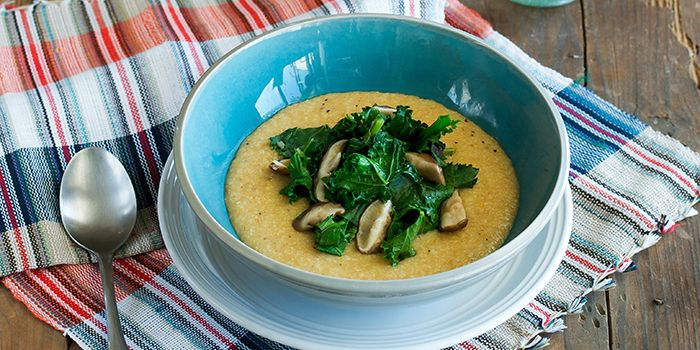 The addition of nutritional yeast and a little vegan butter gives this grits and greens recipe a cheesy flavor without the cheese.
