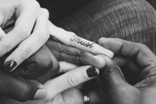 matching TRUST tattoos