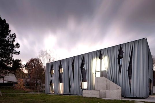 The renovated Aichinger house in Austria has curtains on the outside!