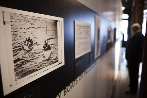 A photograph of lifeboats containing survivors from the sinking of the Titanic hang on the wall at an exhibit in the South Street Seaport Museum commemorating the 100th anniversary of the sinking of TITANIC