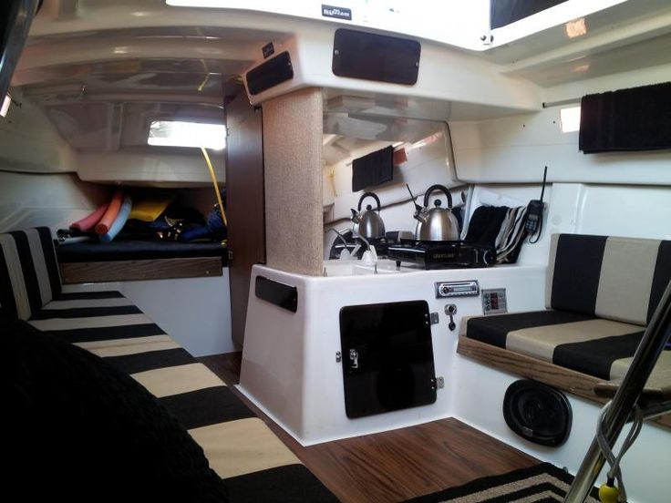 MacGregor 26 Interior with custom cushions and flooring.
