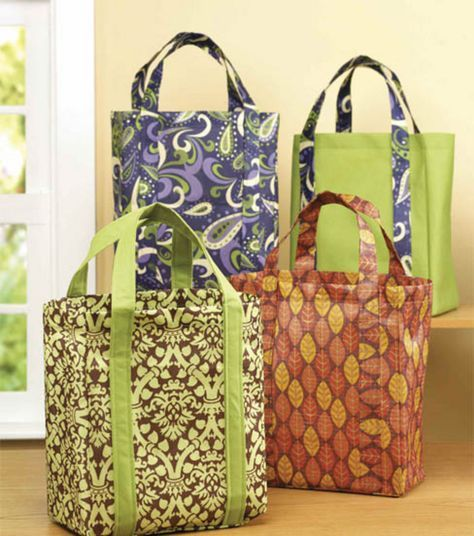 "Shopping bag fabric: Two pieces 16"" x 12 1/2"" for front and back One piece 9"" x 43 1/2"" for sides and bottom Two pieces 5"" x 44"" for straps. ASSEMBLY: 1. Fold straps in half lengthwise and press. Open and fold edges in to middle. Refold and press. Place inside edge of strap 3"" in from each edge of front. Top stitch both sides of strap to approximately 5"" from the top. Repeat with back piece. Reinforce corners and clip. 3. Using 1/4"" seam, stitch front to side/bottom, clipping and pivoting a"