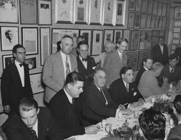 """FDRoosevelt with Mayor Robert Maistri to his right at Antoines where Maestri asked the president, """"How ya like dem dere ursters, Chief?"""" Maistri is said to have had a thick New Orleans accent."""