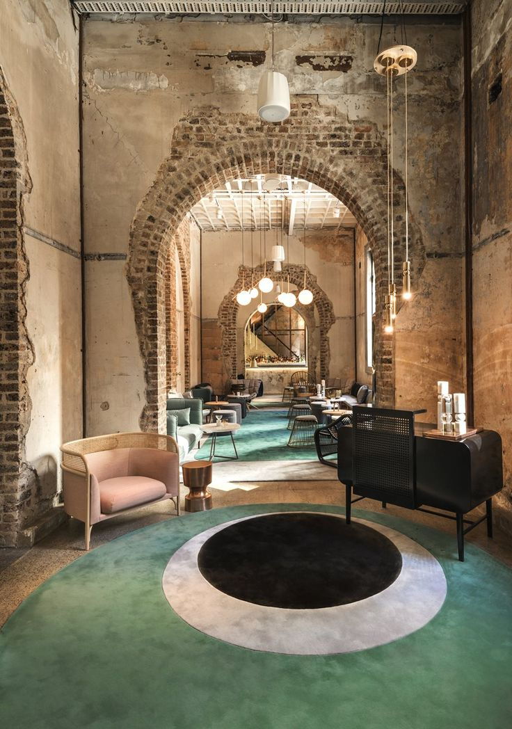 Beta Bar Sydney. raw brickwork and elegant arches with metallic accents and…