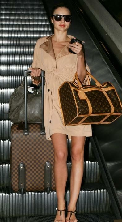 MK traveling with Louis Vuitton