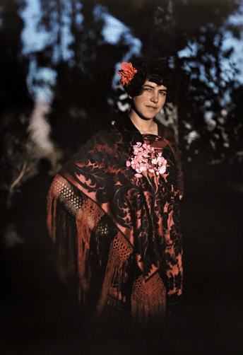 Autochrome: W. Robert Moore.  The daughter of a conquistadore poses in her elaborate poncho. La Paz, Bolivia.