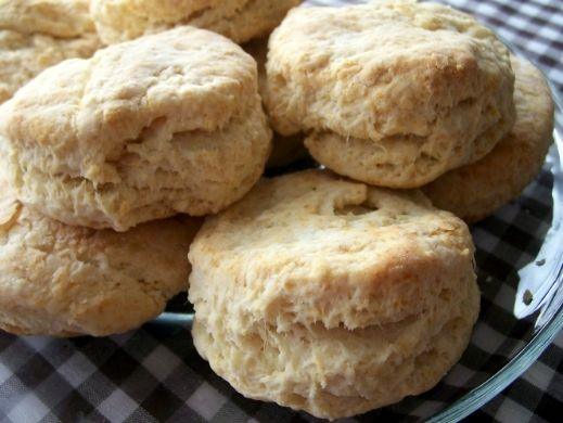 "Tea Biscuits 2 cups flour 4 teaspoons baking powder 1/2 teaspoon salt 5 tablespoons butter 2/3 cup milk Mix flour, baking powder and salt together Cut in the butter until crumbly Add milk Turn out on a lightly floured surface and roll to about 3/4"" thick Cut out circles. Just turn it upside down and press into the dough. Perfect rounds every time Place rounds on a lightly greased cookie sheet Bake at 425 for 20 minutes"
