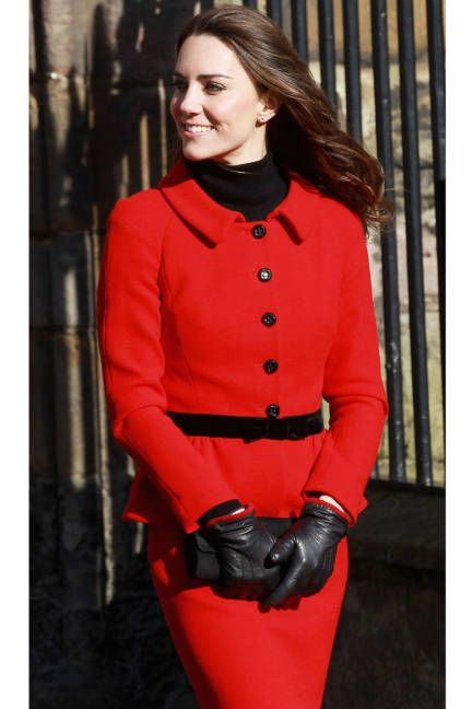 February 25, 2011The future royal keeps warm in a crimson Luisa Spagnoli suit and leather gloves while visiting the University of St. Andrews in Scotland.