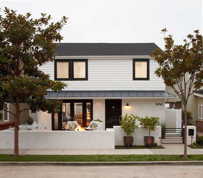 Transitional Exterior by Eric Aust Architect.  White house, black trim and doors.  I like this ... how would it transition to our gray interior?