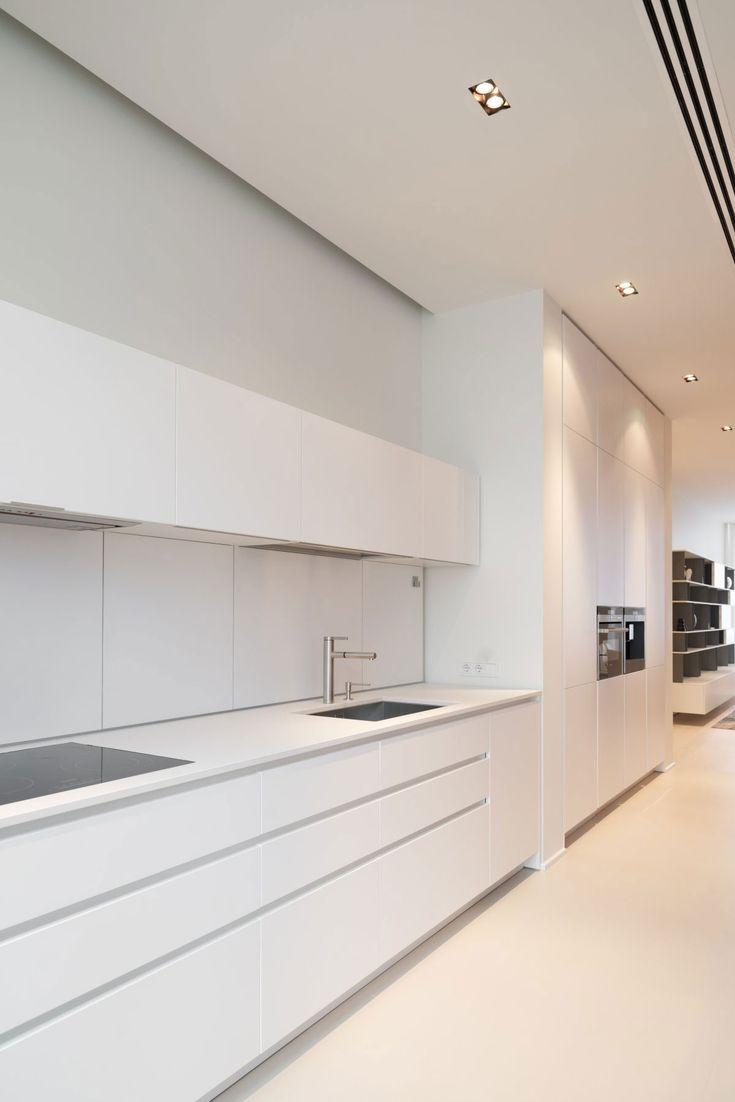 Kitchen minimalist - integrated fridge, no handles, rear sliding door splash back for extra appliance and condiment storage