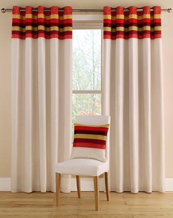 Tropical Terracotta eyelet curtains in bright summer colour-ways have a striped band at the heading. The striped band is a mix of rich summer colours, red, yellow and orange and are combined with a plain, natural coloured bottom to the curtain.