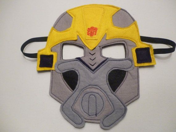 Transformers Bumblebee mask made of felt with one piece of felt as the back to make sure it doesnt scratch. Elastic is stitched at both sides to