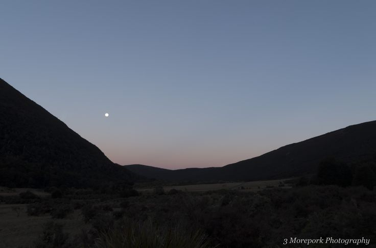 Moon rise during red sunset at Cobb Valley, Kahurangi National Park, New Zealand