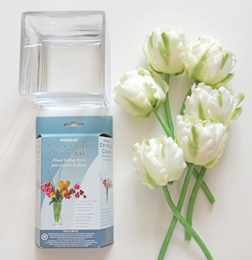 Fake flowers in fake water!  I've always wanted to know how this was done.  I want one for my bathroom!