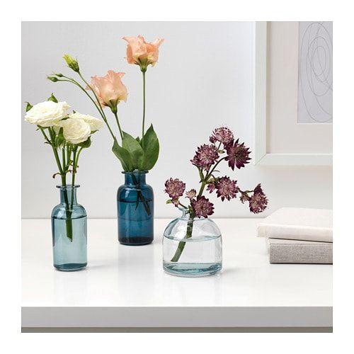 Artificial Orchid dans un petit vase en verre