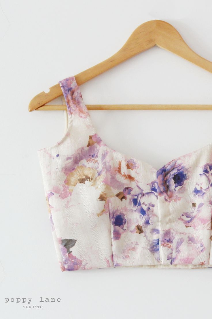 Lilac Garden -   Lovely floral pattern on ivory raw silk fabric. Blouse is tailored sleeveless with a sweetheart neckline and hooks down the back.  Shop now at poppylane.ca