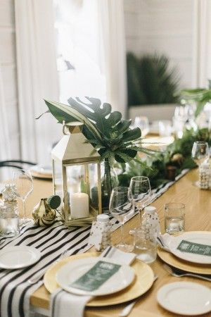 Elegant Botanical Tablescape from @cydconverse with gold dinosaur detail (boy baby shower)