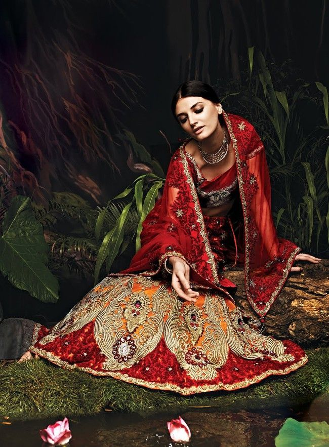 Orange and maroon net lehenga choli with with heavy knot embroidery for wedding and reception party.