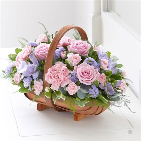 Mixed Basket - Pink and Lilac.A traditional Two Tone Trug Basket filled with roses, veronica, statice and scented freesias in pinks and lilacs.  Picture shows large size arrangement.