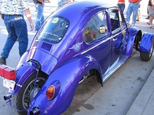 Moto Beetle. VW Bug converted into a 3 wheeler. Bubble, blue, mini, wheels, curves, vehicle, transportation, surreal, photo.