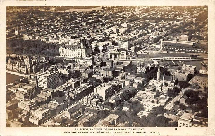 https://flic.kr/p/RAKoyE | Aerial view of Ottawa 1920 | Shows part of the core near the Chateau Laurier, Rideau Canal, Sparks St. The turreted building, centre right, is the City Hall, destroyed by fire in 1931. The former Post Office is near the bridge and was demolished for the construction of the War Memorial. Across the Canal from City Hall are the train sheds of Union Station.
