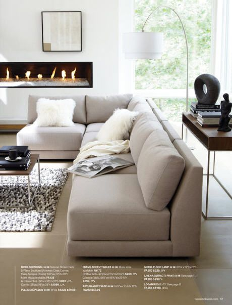 contemporary living room with 'L' shaped sofa and great arc lamp