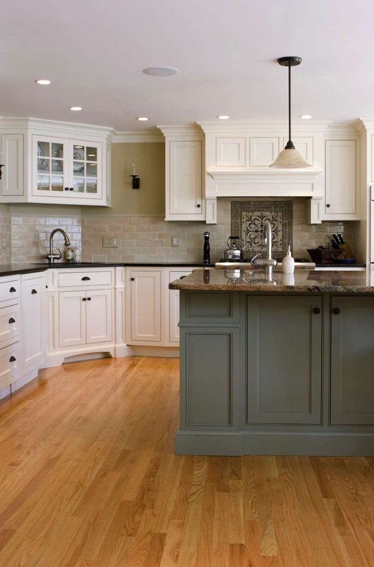 White shaker kitchen cabinets grey floor - Three Strong Trends For 2013 Come Together In This Transitional Kitchen With White Shaker Style