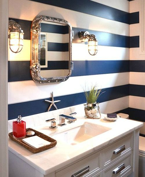Nautical bathroom idea: http://www.completely-coastal.com/2016/04/wall-treatment-ideas-for-bathroom.html Bold navy blue horizontal painted stripes for the walls, porthole mirror and vanity lighting inspired by ship lanterns.