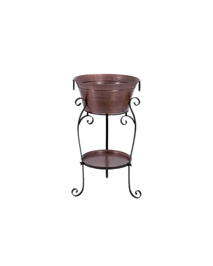 Copper Hammered Metal Wine Cooler Stand - This metal wine cooler consists of a wine cooler bucket mounted on a metal stand. The design of this metal wine cooler suits the requirements of the modern home. It has a big wine bottle bucket that can hold a dozen of wine bottles along with ice cubes. The cooler stand is made of high quality metal that has greater heat resistance, so you can keep the bottles cooled for a long time.