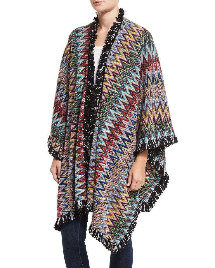 """Missoni fringe poncho in signature zigzag knit. Approx. 30""""L from shoulder to hem. Shawl collar; open front. Relaxed fit. Asymmetric hem. Wool/rayon fringe/wool. Made in Italy."""