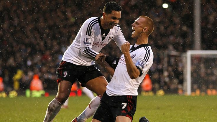 Fulham's English midfielder Steve Sidwell (R) celebrates scoring their first goal with Fulham's English midfielder Kieran Richardson (L) during the English Premier League football match between Fulham and West Ham United at Craven Cottage in London on January 1, 2014.