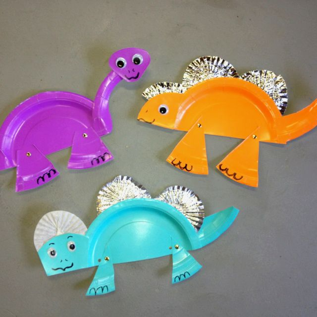 Dinosaurs! One paper plate,muffin wrappers, two brads, two eyes, glue, and scissors. A great craft for dinosaur weekend at camp!