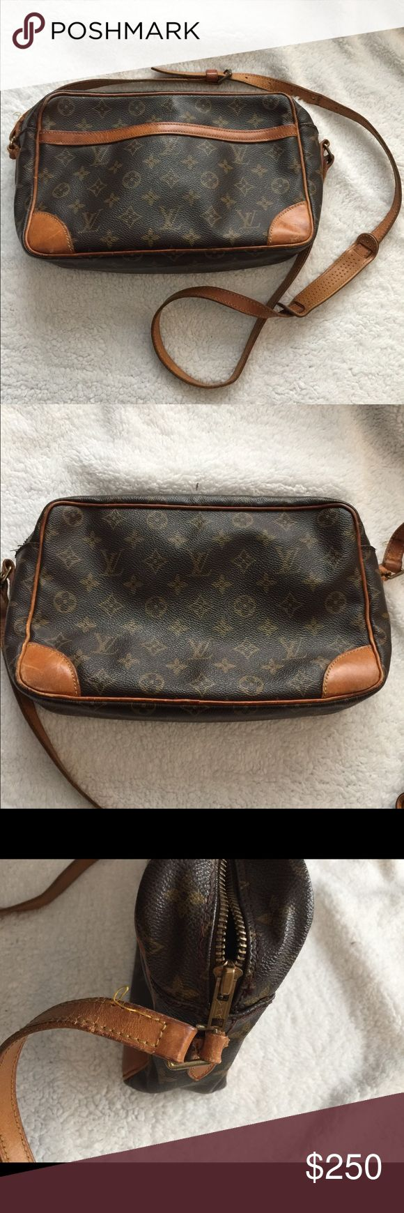 Original Louis Vuitton Trocadero Cross Body Purse Original REAL Louis Vuitton from Paris.  Please see pictures for condition, outside canvas is in good condition as are corners and hardware is working. Inside has dirt, scratches, stains and pen marks. Louis Vuitton Bags Crossbody Bags
