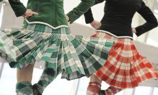 Two Highland dancers, wearing kilts, at the Gathering, Holyrood Park, Edinburgh