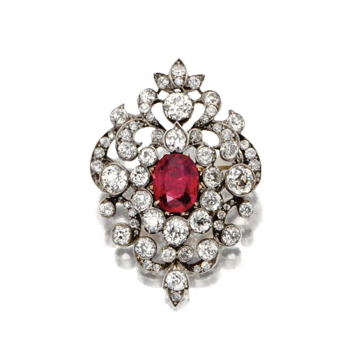 SPINEL AND DIAMOND PENDANT-BROOCH, CIRCA 1890. The scrollwork cartouche set with 67 old European-cut diamonds weighing approximately 4.00 carats, centering a cushion-shaped red spinel weighing approximately 2.00 carats, mounted in silver and gold, brooch pin detachable.