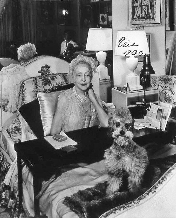 In 1950, Lady Mendl was photographed, with one of her poodles, in her bedroom at After All. Courtesy of Hutton Wilkinson