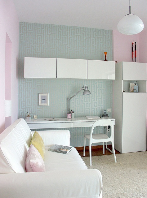 Ikea Besta Burs workstation in high gloss white  and Wall Cabinets in white.  Home office by Ikea