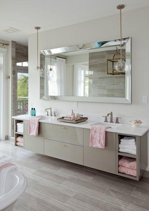 Stunning bathroom featuring a floating gray double vanity - Pendant lighting over bathroom vanity ...