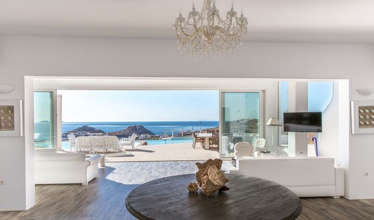 Built on a plot of 7000 square meters overlooking two of the trendiest beaches of Mykonos (Kalo Livadi & Kalafatis), this grand villa offers elegance, style and beauty all combined in a perfect way with the Mykonian traditions and architecture. Every single corner is tastefully furnished and decorated while boho-style touches are seen here and there.