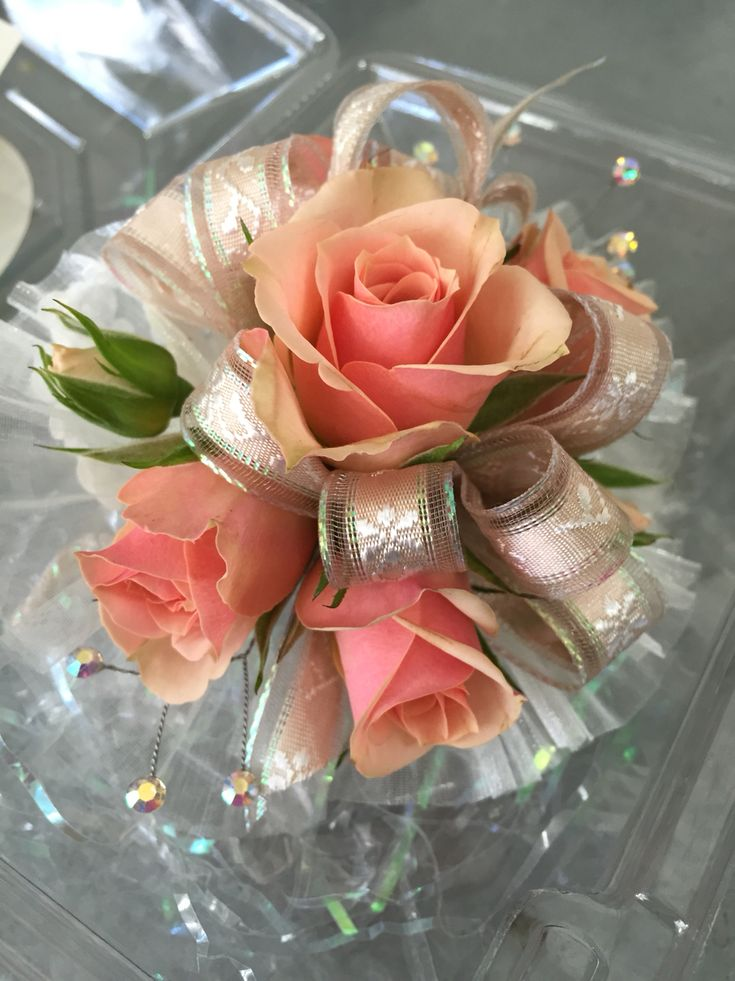 Wristlet corsage with peachy pink spray roses