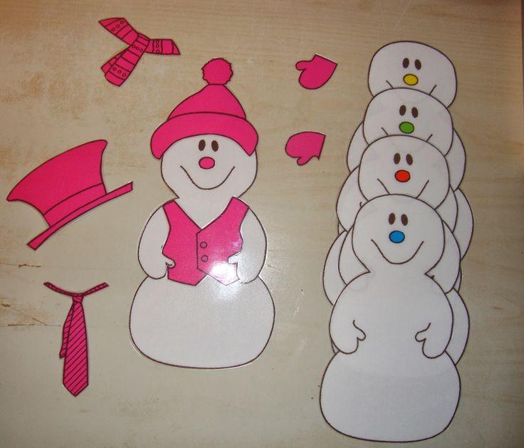 de sneeuwman aankleden volgens de juiste kleur