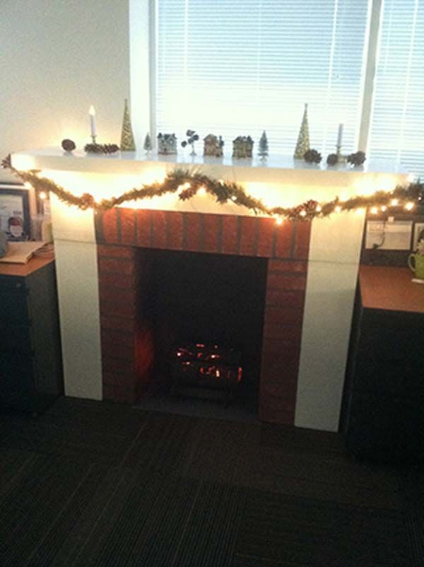 With a few cheap decorations...this awesome Office Worker Created a Fireplace Out of CARDBOARD BOXES!!! Wow this is just SPECTACULAR!!