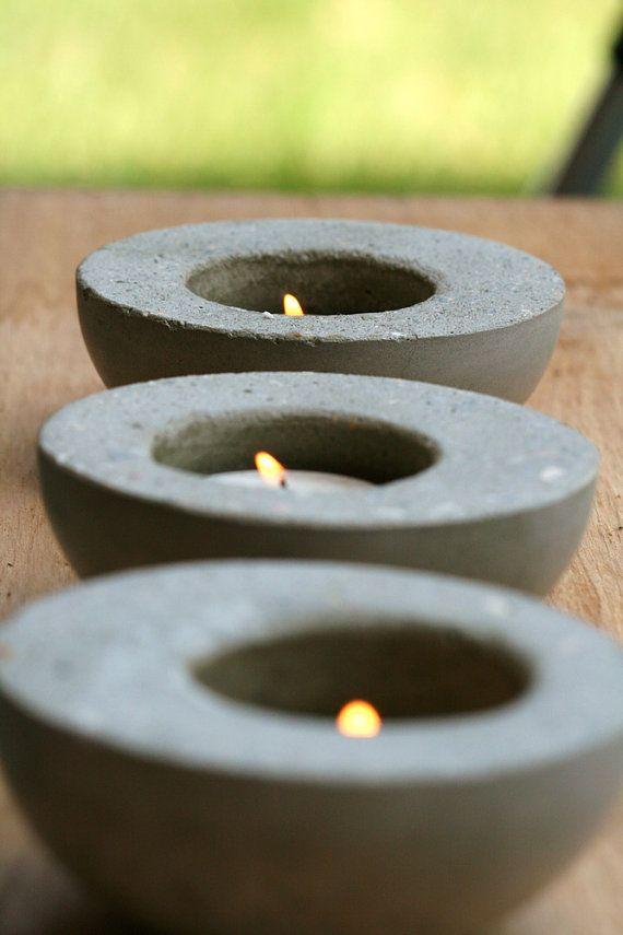 Make concrete candle / votive holders. Looks easy enough :)