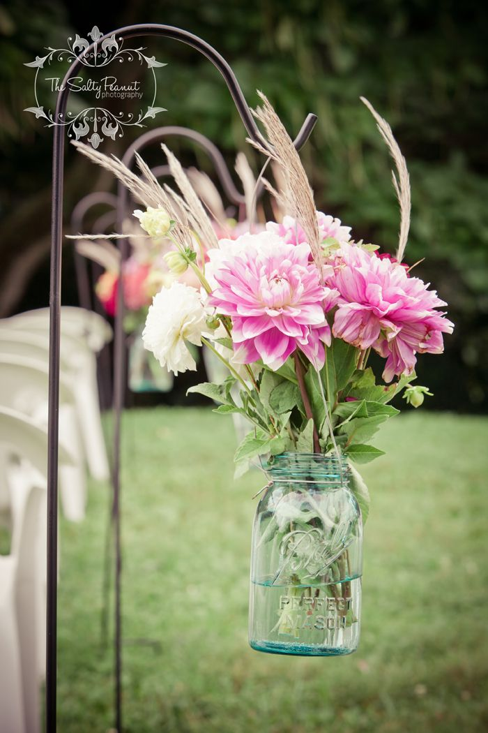 why not put a shepard hook next to the patio and fill that jar with a live plant, fresh cut flowers from your garden or even a candle at night time!!!