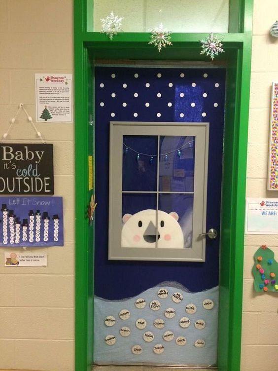 """This is my preschool classroom door. My hubby built the frame of the window and put plexiglas for the window. He cut the bear out of High R sheeting and I covered the bear with batting. I used felt shapes as the elements of the bear. The light and dark blue are felt. The bottom """"snow"""" is tulle."""