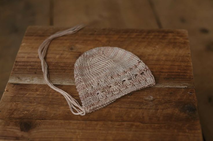 Beautiful baby hat knitted in Perran Yarns 4ply silk seacell in shade 'She Sells Seashells' by Meadow Lane Props