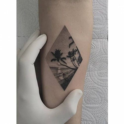 Fine line style beach rhombus tattoo on the inner forearm....