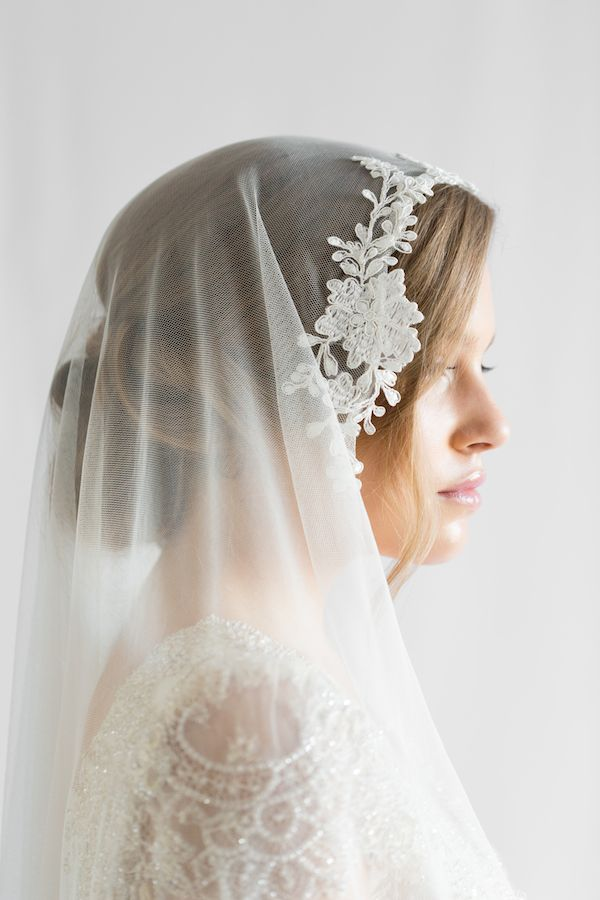 The Aurora chapel length veil is a dreamy and dramatic piece, featuring an ivory corded lace trim and buttery soft netting.